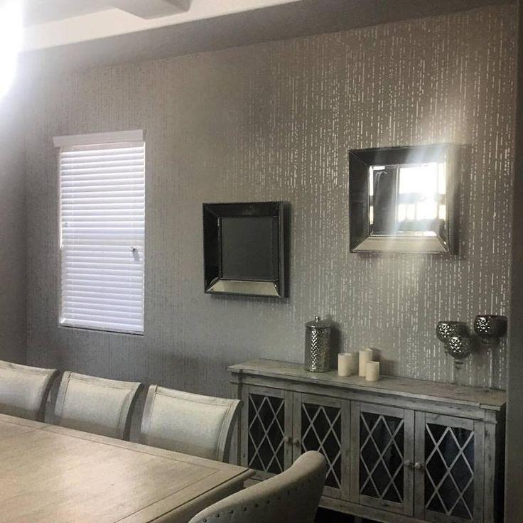 A metallic silver stenciled accent wall in a dining room using the Rain Wall Stencil from Cutting Edge Stencils.  Project by Stettiehand    http://www.cuttingedgestencils.com/rain-stencil-pattern-modern-stencils-wallpaper-stencil-design.html
