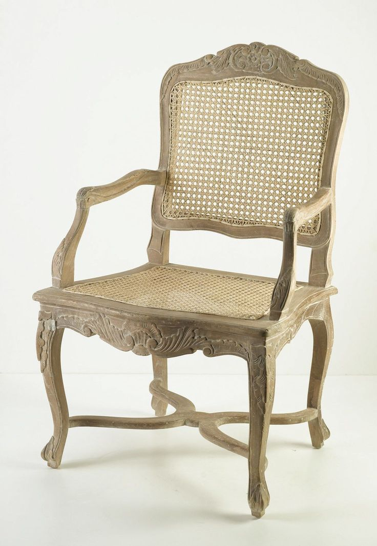 """Features:  -Hand carved.  -Wicker seat and back.  -Tasteful distressing.  Distressed: -Yes.  Frame Material: -Wood.  Arm Material: -Wood. Dimensions:  Overall Height - Top to Bottom: -40.5"""".  Overall"""