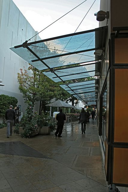 IMG_2540 glass awnings in the rain by godutchbaby, via Flickr