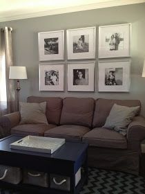 Big picture frames behind couch.
