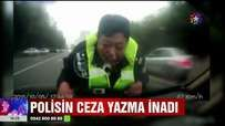 Ceza yazma inadından vazgeçmeyen Polis 2 Kilometre kaputta gezdi