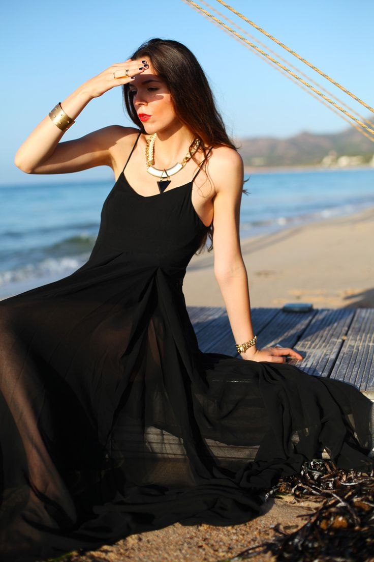 A classic black dress for the beach is a summer staple