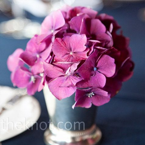 Pink Hydrangea Centerpieces    Instead of a single large arrangement, lots of small ones (like these pink hydrangeas) made up the table centerpieces.