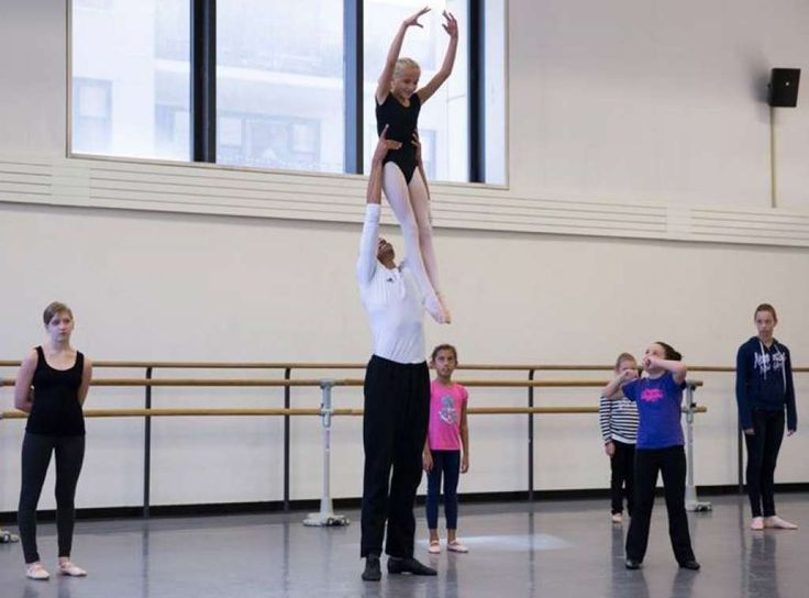 Silas Farley, New York City Ballet teaching artist, lifts Tess Keating, of Darien, during a visit to the New York City Ballet rehearsal studios. Photo: Contributed Photo, Contributed / Darien News