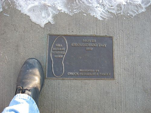 "Groundhog's Day Fun Fact: The movie was filmed in Woodstock, Illinois. In Woodstock, there's a small plaque that reads ""Bill Murray stepped here"" on the curb where Murray continually steps into a puddle."