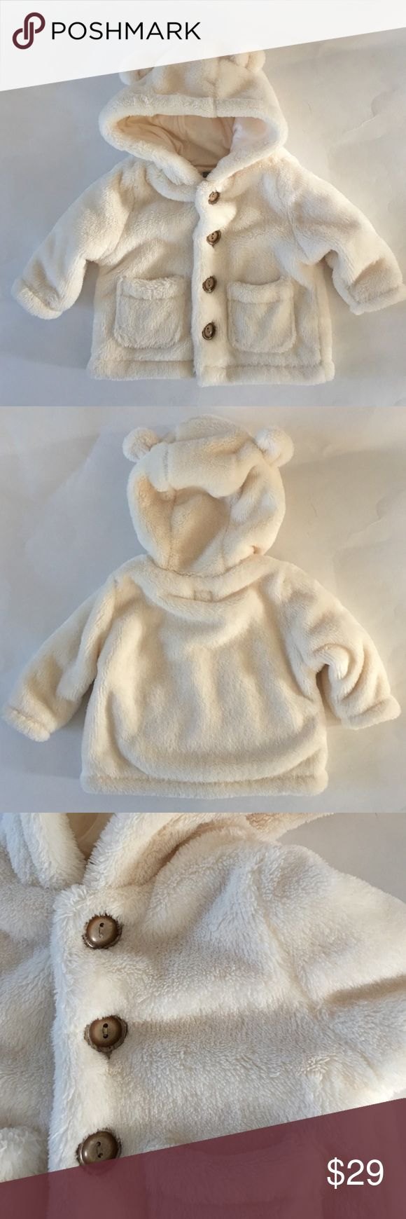 NWOT Baby Gap Jacket Nice and warm with super cute hood with little ears.  Fully lined in 100% cotton.  Feels like a furry fleece.  Really love but size was not the right season for us.  Never worn. GAP Jackets & Coats