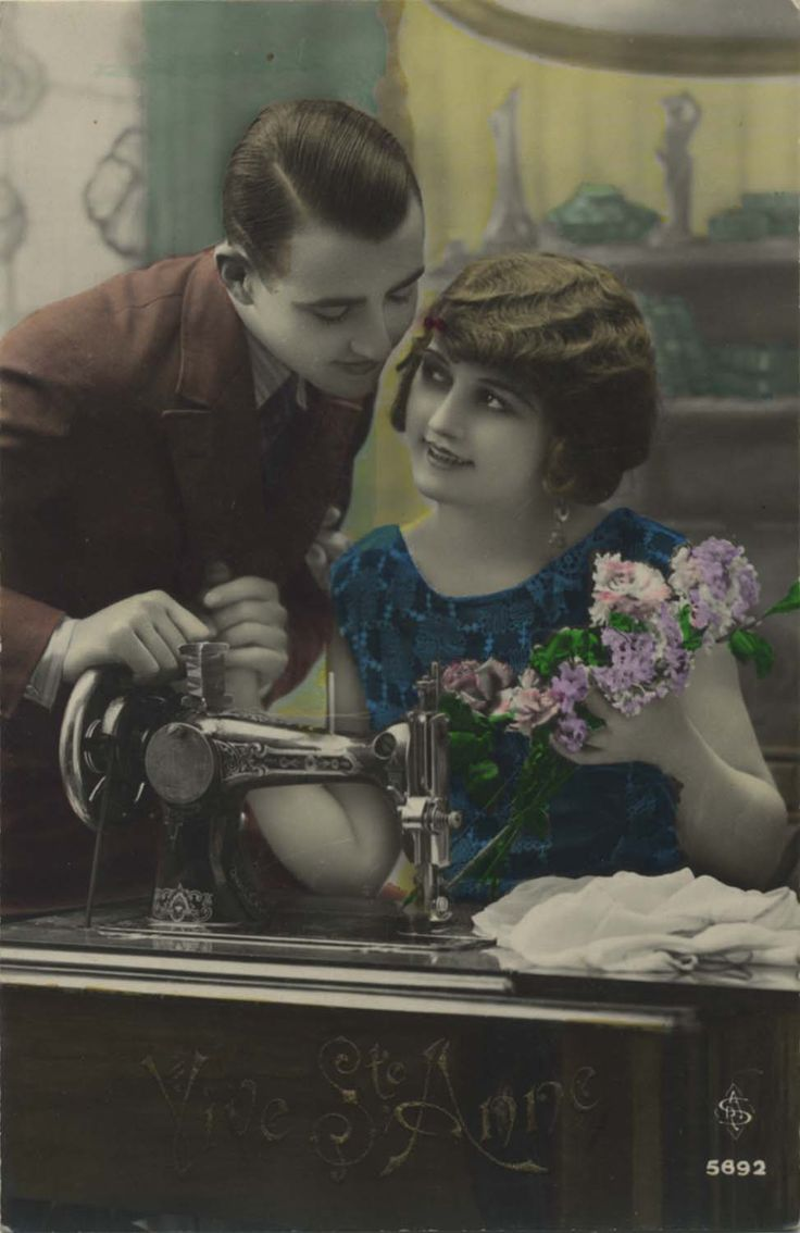 Vintage sewing postcard - couple posing with sewing machine.