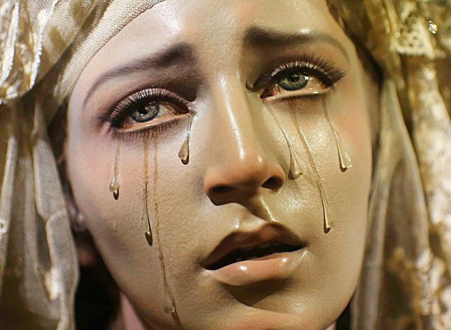 """A wooden carving of """"Virgen de los siete dolores y Madre de todos los que lloran"""" (Virgin of the Seven Sorrows and Mother of all those who cry) by Spanish artist Francisco Romero Zafra, is displayed in a church in the Andalusian capital of Seville, southern Spain August 9, 2013. (Photo by Marcelo del Pozo/Reuters)"""