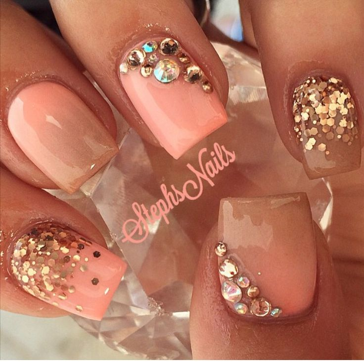 Coral sparkle and rhinestone nail design