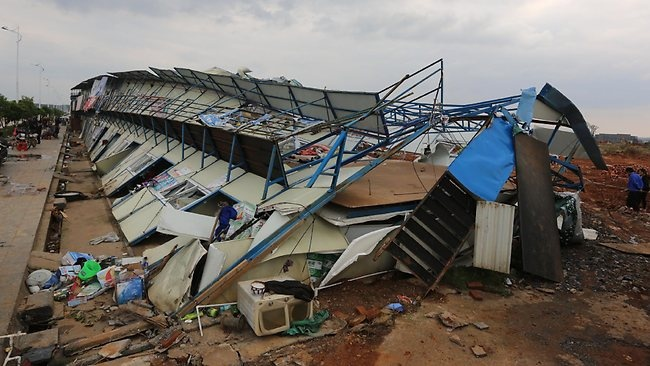 Damaged prefab houses lay on the ground after a tornado carrying egg-sized hail hit Yongzhou, in central China's Hunan province. Picture: AFP