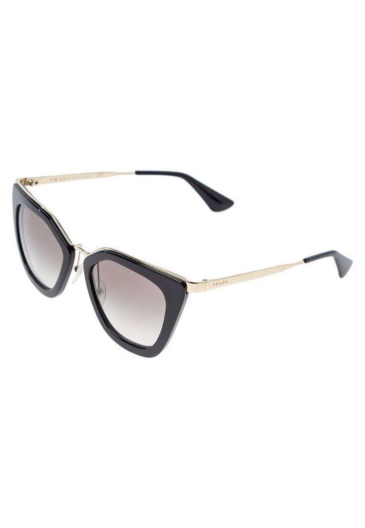 Prada. Lunettes de soleil - black. Forme des lunettes:papillon. Étui à lunettes:Étui rigide. Longueur des branches:15 cm en taille 52. Avantage des verres:vue claire et sans distorsion. Filtre UV:oui. Largeur du pont:1.7 cm en taill...