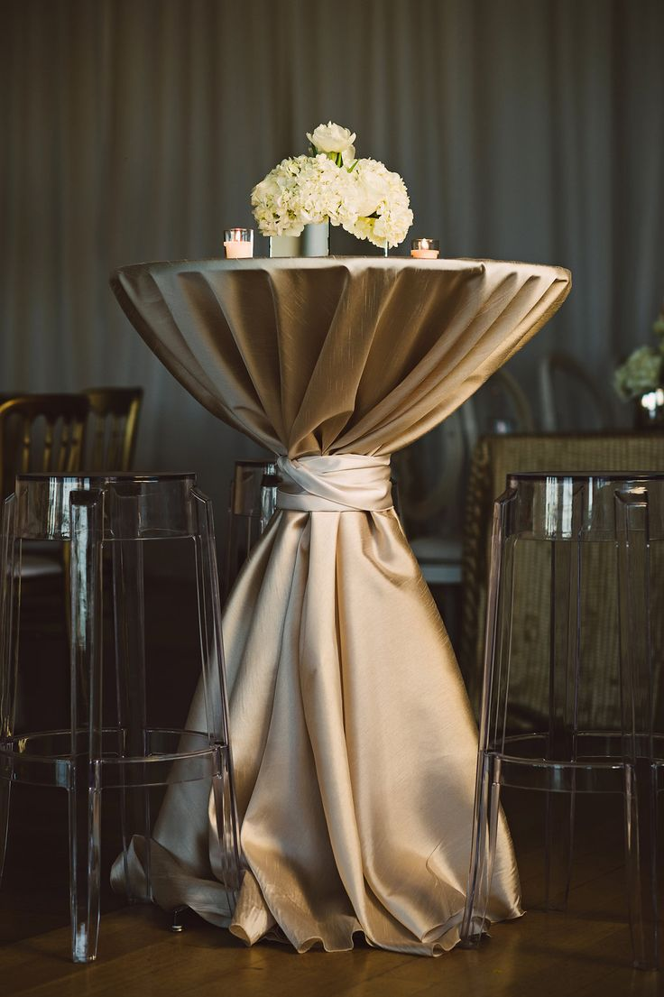 Golden Cocktail Hour Table | Photo: Crystal Stokes Photography. View More: https://www.insideweddings.com/weddings/white-winter-wedding-at-an-art-museum-in-charlotte-north-carolina/871/