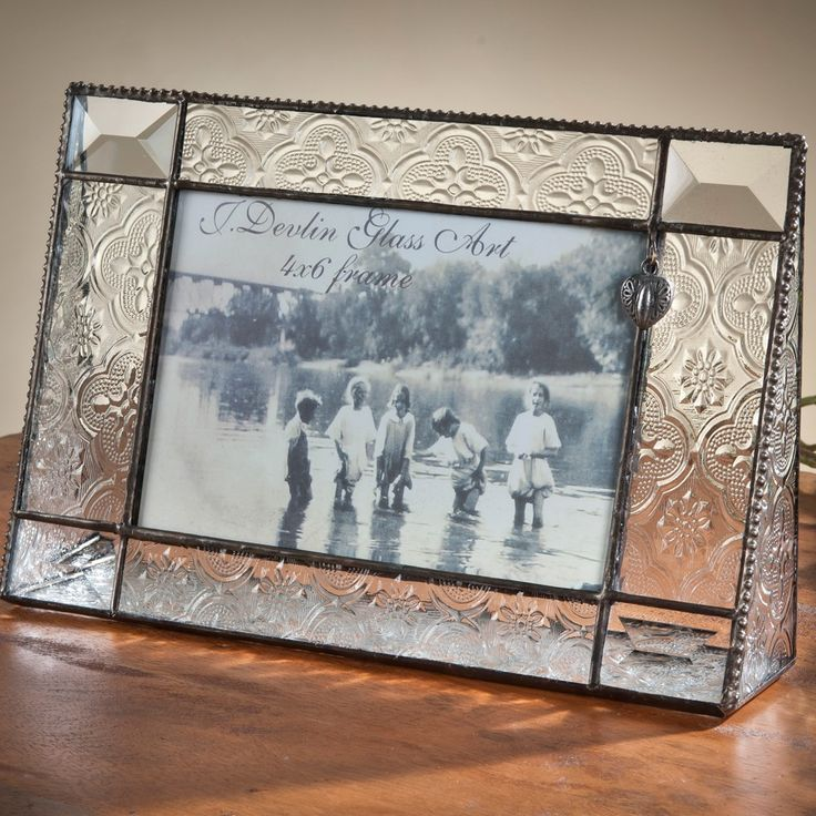 Vintage & Bevels glass photo frame has a dangly heart charm to sweeten your memories.