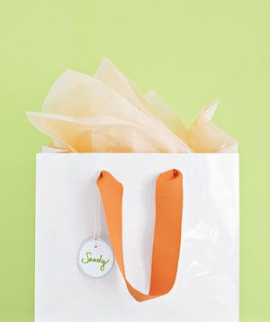 Super great idea!! Give an inexpensive white gift bag a makeover with