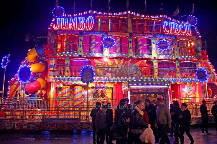 """Another view of the Jumbo Circus Fun House with """"5 Floors of Fun"""" at the Hull Fair in England. The slogan covering the width above the entrance reminds fair visitors of the age-old mantra, """"There's no business like show business!"""" (photo by Steve Barton in 2013, more at flickr.com/photos/gaffcatcher"""