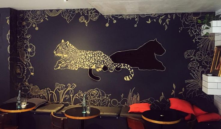 Leopard mural at The House Dining cafe by Imogen Renee Rose