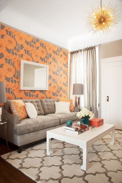 A bold wallpaper in a small living room draws attention away from the size of the room and injects instant personality.