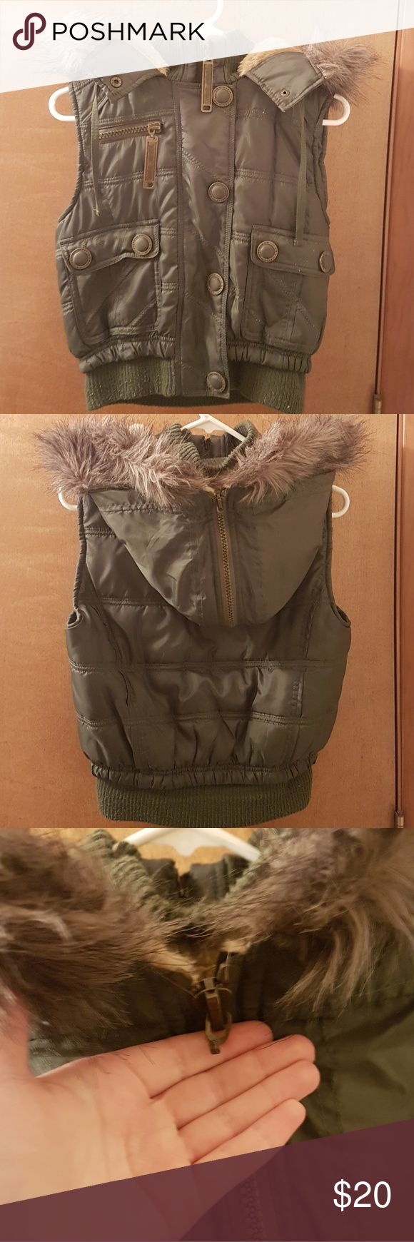 Wet Seal olive green puffy vest Wet Seal olive green puffy vest in GREAT condition only flaw is the missing zipper on the hood Wet Seal Jackets & Coats