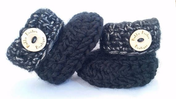Handcrafted black baby booties with complimentary gift box and