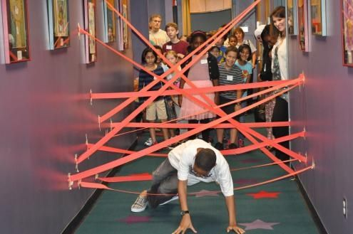 put streamers on the wall and have the kids go through like an obstacle course.