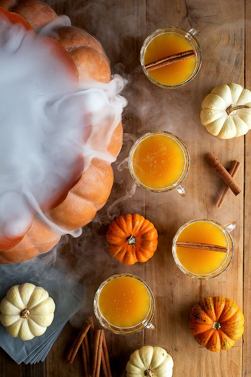 Halloween Pumpkin Rum Punch Recipe: Rum + OJ + lemon juice + spiced syrup + pumpkin + sparkling water. Dry ice for creepy look. Click for recipe.