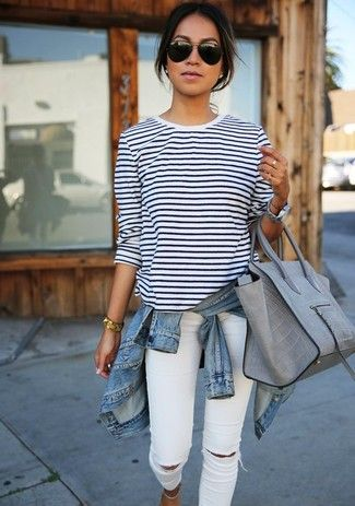 light blue denim jacket, white and dark blue horizontally striped long sleeve shirt, white tight jeans with destroyed effects, gray leather tote bag for women