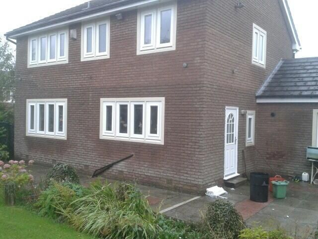 Replacement windows & doors installed in white PVCu By Astra Windows