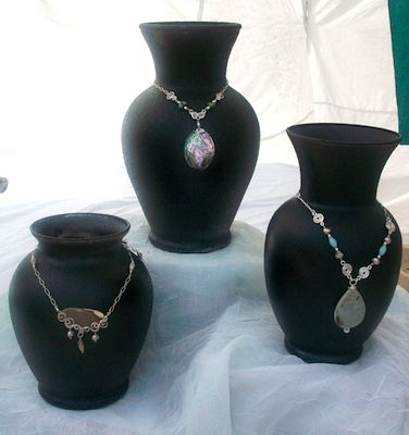 Vases painted black, use as awesome necklace displays. put some beads, marbles, or plaster in bottom to weight them.