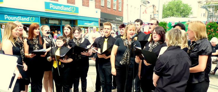 Community Choir performing in Andover Town centre