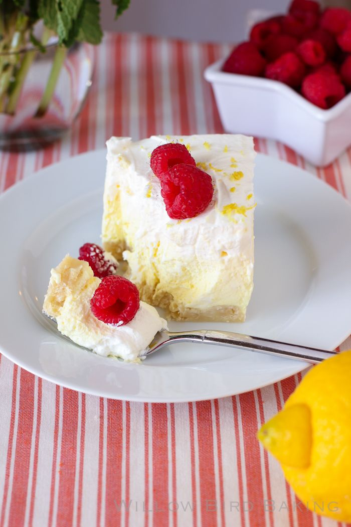 Lemon Cream Pie Bars | These bars are a BRIGHT burst of sunshine! The lemon flavor isn't the knock-you-out sort, but a sweet, smooth punch in a bed of whipped cream. You're gonna love these! @Willow Royston Royston Royston Bird Baking