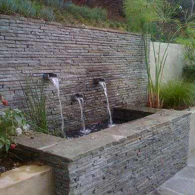 Spout style for wall water feature - also like style of central decorative tile (would choose different tile) with a smooth stucco finish walls on either side for pool perimeter wall. The central decorative tile will stand out more with the smooth stucco walls on either side.