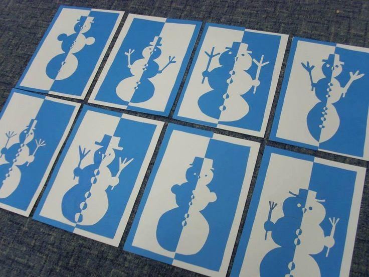 sněhulák -  osová souměrnost: technika pozitiv-negativ..na barevný papír, v tomto případě na modrý, předkreslíte motiv (půlku sněhuláka)..po vystřižení nalepíte na bílou čtvrtku přesně naproti sobě - to, z čeho jste vystřihovala a to, co jste vystřihla