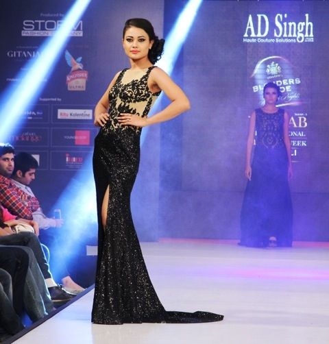 Black & nude red carpet gown with long slit from AD SINGH Couture. to buy shop online on www.adsingh.com or email: info@adsingh.com