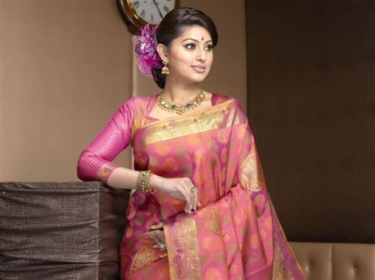 Nayanthara, Trisha and Bhavana sizzle in Saree Ads....who is the best....Vote now - Page 39