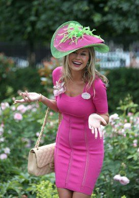 Racegoer Esther Dohnalova poses for photographers during Day Three of the 2014 Royal Ascot Meeting at Ascot Racecourse, Berkshire.