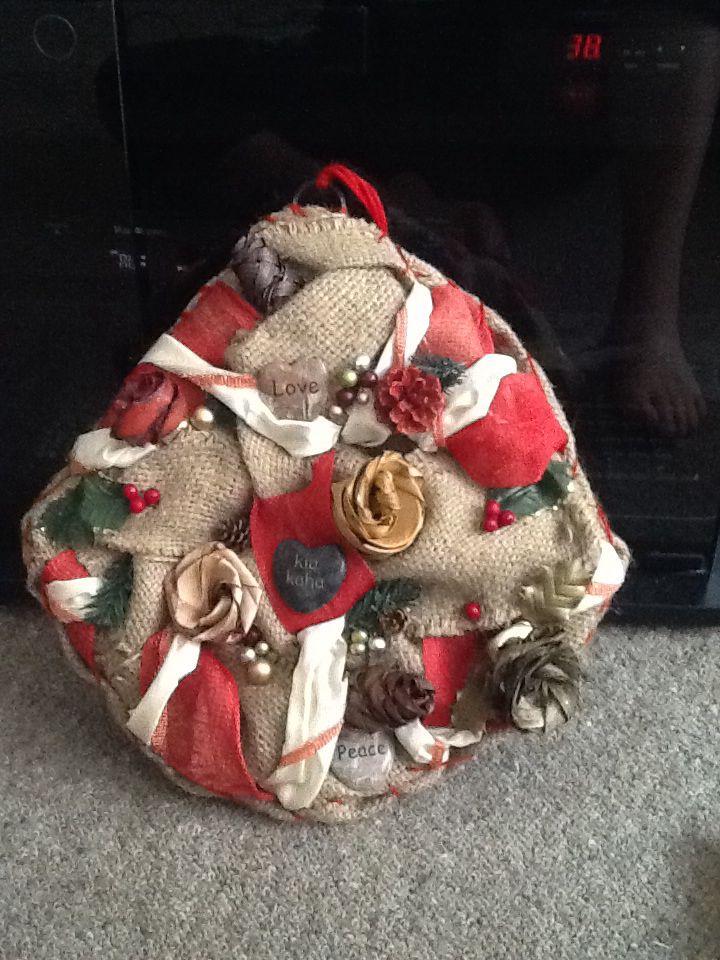 Xmas wreath... Love/ Kia Kaha/ Peace...made with burlap, stones, harakeke putiputi and much Love
