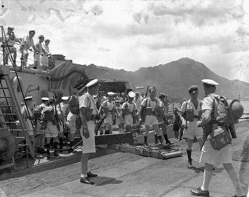 https://flic.kr/p/apGJFA | Landing party disembarking from HMCS Prince Robert during the liberation of Hong Kong / Compagnie de débarquement du NCSM Prince Robert mettant pied à terre durant la libération de Hong Kong | Title / Titre :  Landing party disembarking from HMCS Prince Robert during the liberation of Hong Kong /