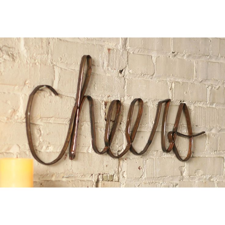 I've been seeking something unique for one of my living room walls.   This might be it! Scrap Cheers Wall Art