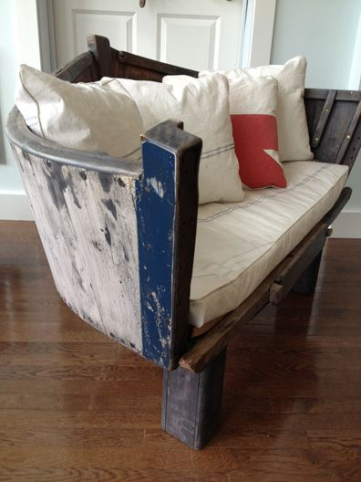 A clever artisan turned an old boat into into a love seat with plush seating—the perfect reading perch for any beach home.