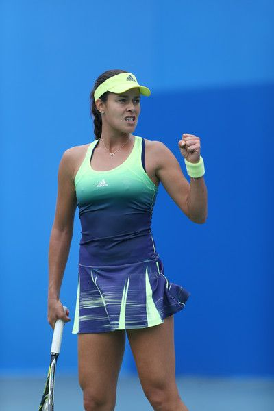 Ana Ivanovic Photos Photos - Ana Ivanovic of Serbia reacts during the match against Madison Brengle of USA on Day 3 of 2015 Dongfeng Motor Wuhan Open at Optics Valley International Tennis Center on September 29, 2015 in Wuhan, China. - 2015 Wuhan Open - Day 3