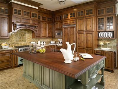 Kitchen features oak end-cut flooring,knotty alder cabinets and knotty alder millwork.