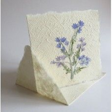 Fairtrade Flower decorated double card with envelope. Handcrafted of bark, water and fresh flowers.