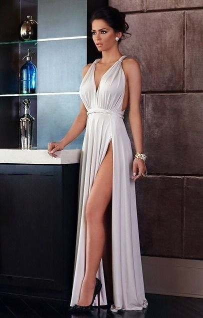 Great Legs and Stylish High Heels — Sexy legs peeking through a high slit dress