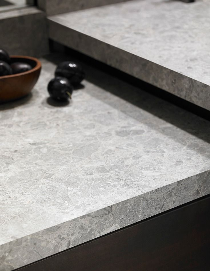 """Think beyond traditional granite for your interior design, to aggregate stones and engineered surfaces. This trend is inspired by those who prefer something more unique than traditional granite or marble.      9307-34 Silver Shalestone is a perfect example of this trend, featuring a breccia (Italian for """"loose gravel"""") stone design reminiscent of the color of natural cement.   Click through to order your free sample of Silver Shalestone."""