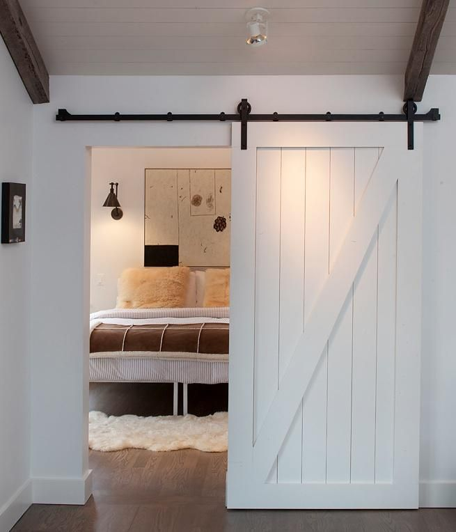 The door to a bedroom in a Mill Valley, California home by Artistic Designs for Living.