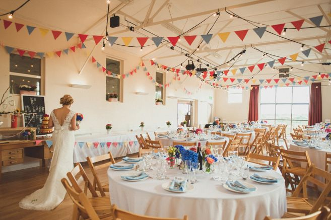 Colourful décor for a charming village hall wedding | Photography by http://alexapenberthy.com/