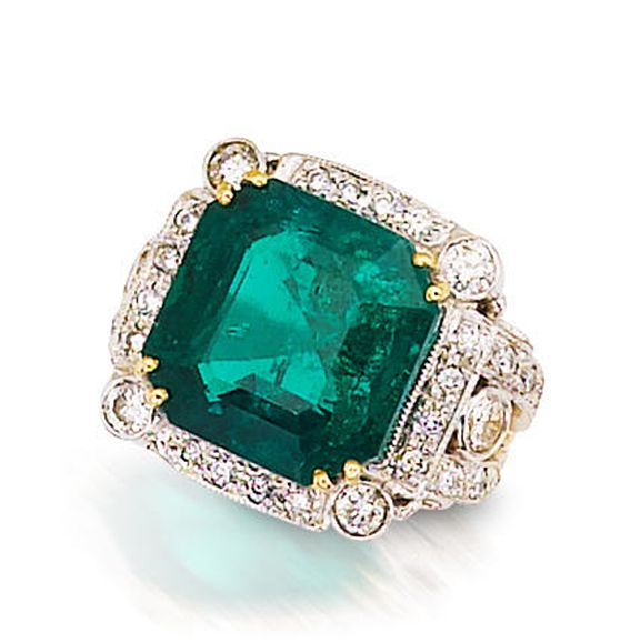 An emerald and diamond ring centering a square-cut emerald within a round brilliant-cut diamond surround and diamond-set bifurcated shoulder