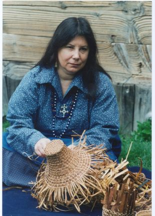 Judy Bridges, a member of the Cowlitz Indian Tribe, is descended from five fur traders and their Native American wives. Her baskets use both traditional and modern materials. She took up basketry in the early 1990s, studying with both native and non-native teachers. She has been teaching and demonstrating basketry for more than a decade.