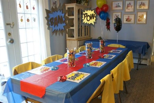 solid color tablecloths layered will be less expensive than printed themed ones. I think these clip art Bam & Pow signs would be super simple to make for wall decor.