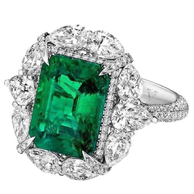 7.34 Carat Unique Emerald Diamond Ring  | Ring in 18kt white gold set with one octagonal cut Emerald (4.48 carat), 10 pear-shaped diamonds (2.07 carats), and 166 brilliant-cut diamonds (0.79 carats) Diamond Clarity: Vvs1, Diamond Color: E, Cut: Excellent